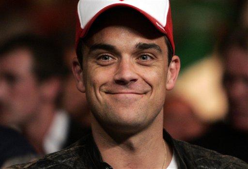 Robbie Williams quiere educar a su nueva hija en Reino Unido