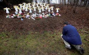 Newtown entierra más  víctimas
