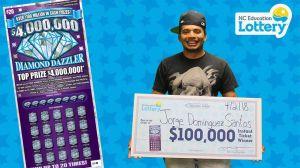 """Trabajador latino para a comprar un jugo, juega la lotería y se lleva el """"gran premio"""""""