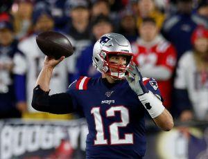 ¡Otro día en la oficina! Tom Brady rompió records por aire y por tierra contra NY Giants