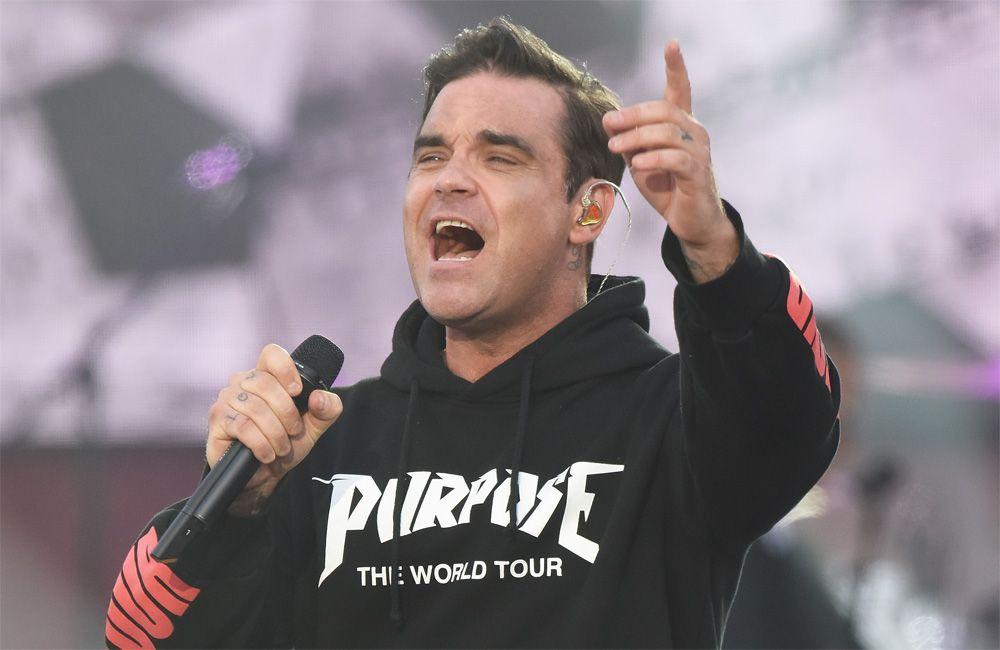 Robbie Williams reta a su viejo enemigo Liam Gallagher a un combate