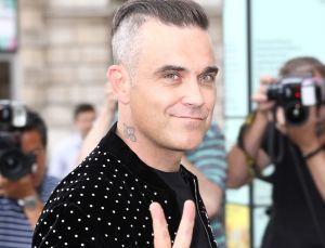 ¡En plenas vacaciones! Robbie Williams da positivo a Covid-19
