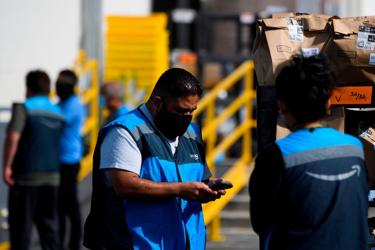 What happens in the economy when Amazon raises wages