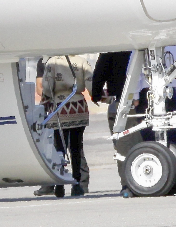 Jennifer Lopez and Ben Affleck were caught holding hands before getting on the plane.  / The Grosby Group
