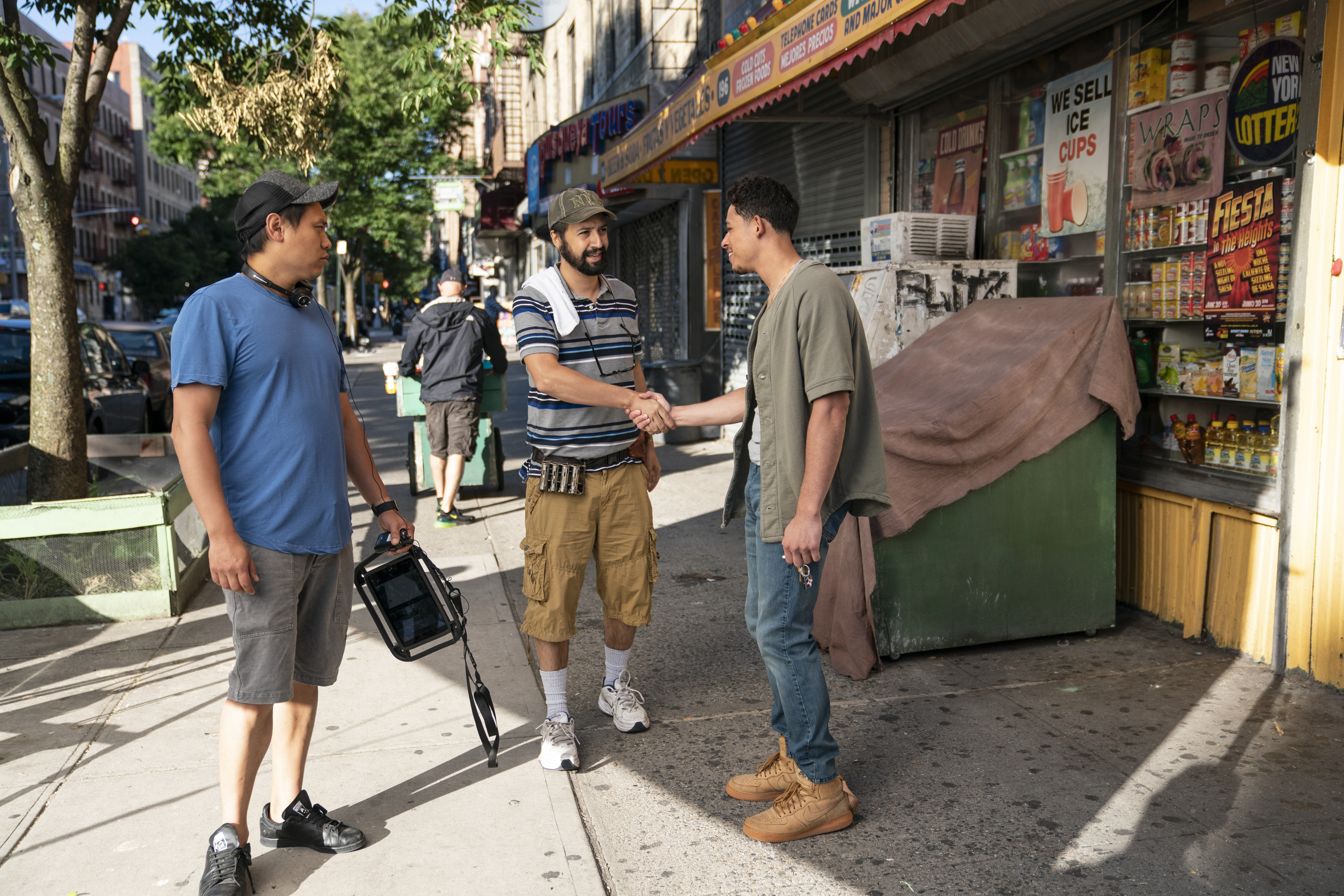 Anthony Ramos greets Lin-Manuel Miranda during the filming of In the Heights.