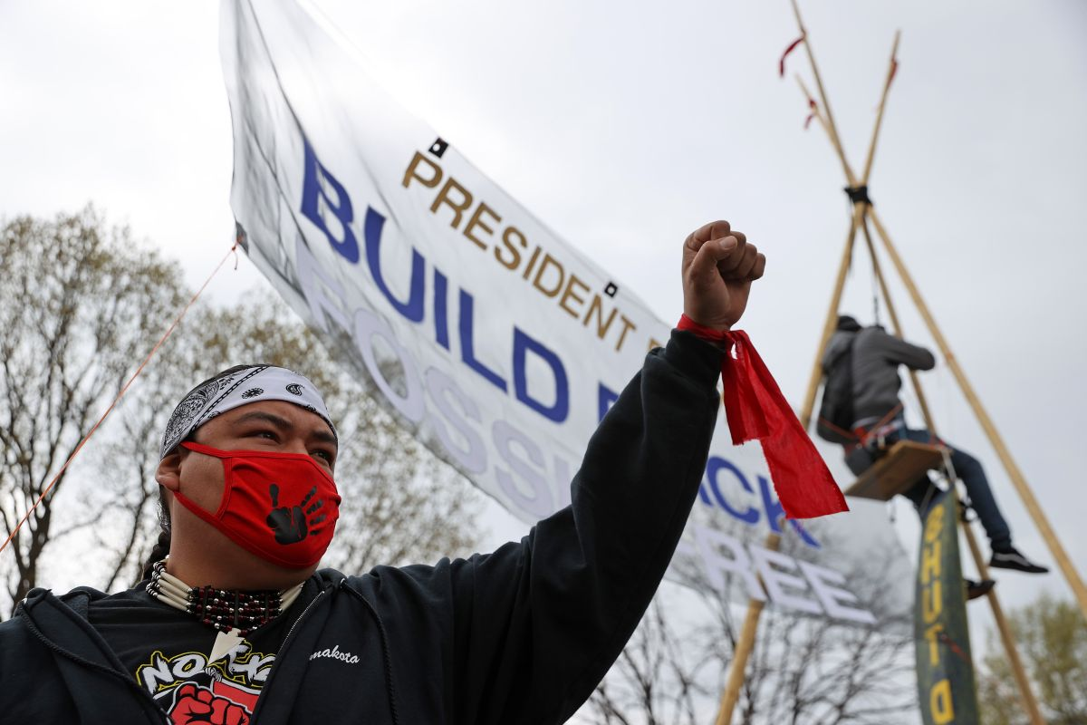 Climate activists protested around the White House and vandalized Andrew Jackson's statue