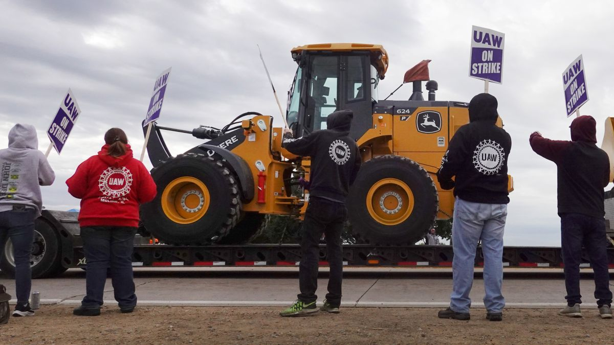 More than 10,000 John Deere workers go on strike at 14 US plants.